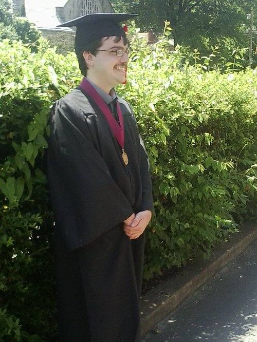 David in his robes, with honors medallion, before diploma ceremony